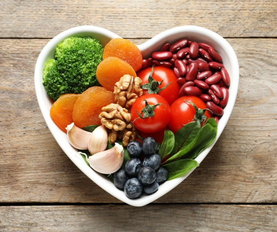 Heart shaped bowl of healthy vegetables